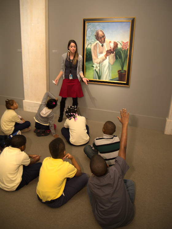 A NPG museum educator leads a group of students through a looking activity.
