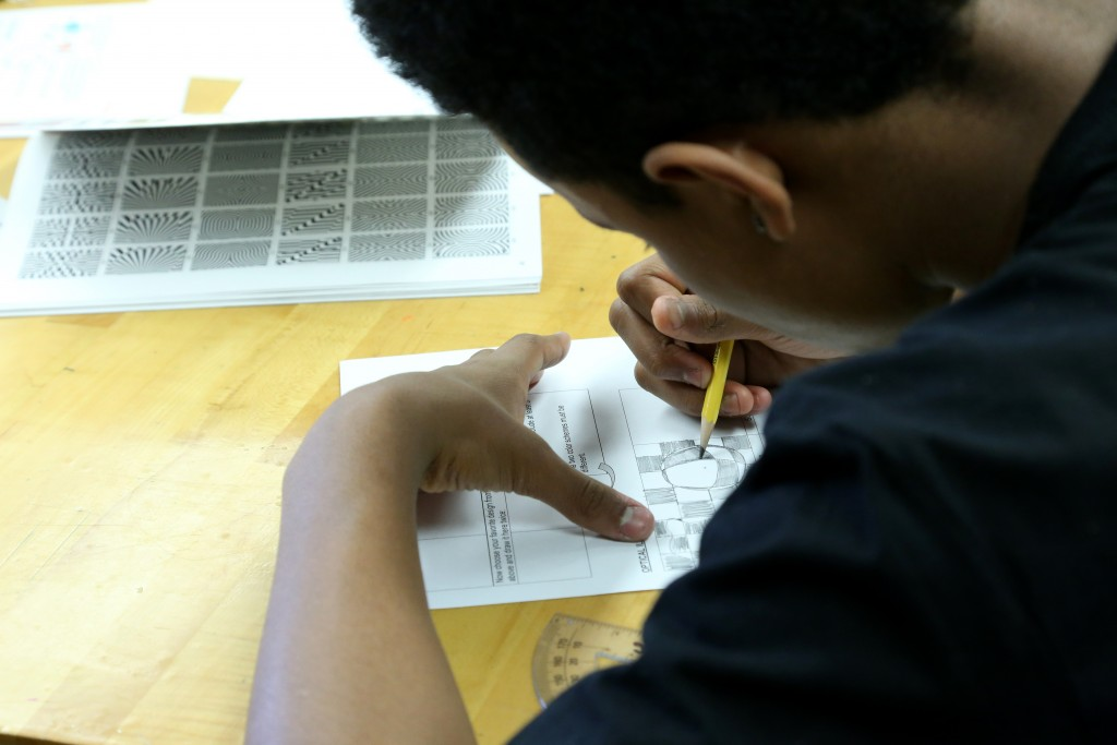 student working on optical illusion drawing