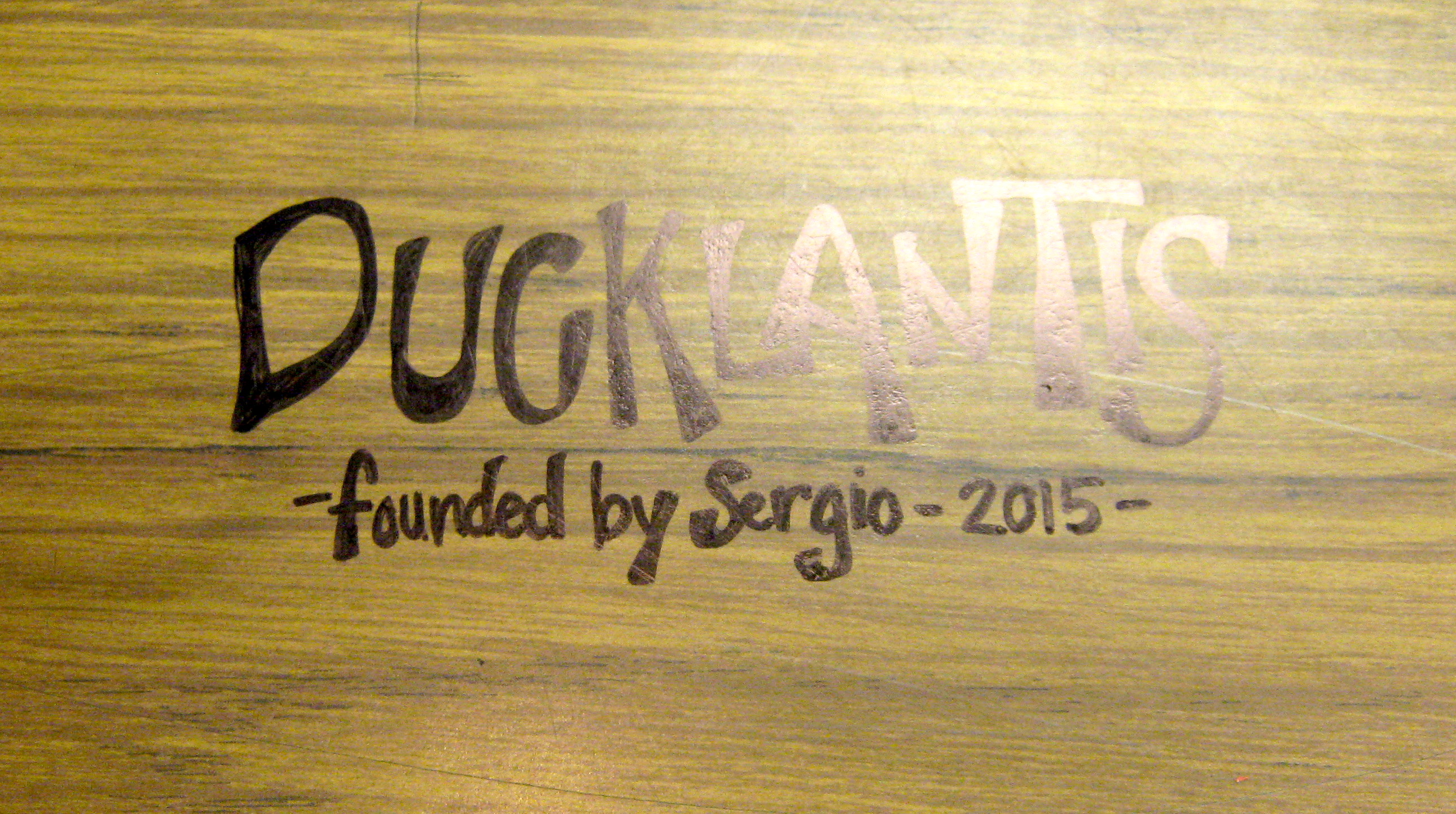 desk with word Ducklantis written on it