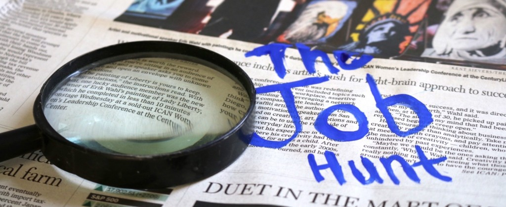 newspaper and magnifying glass