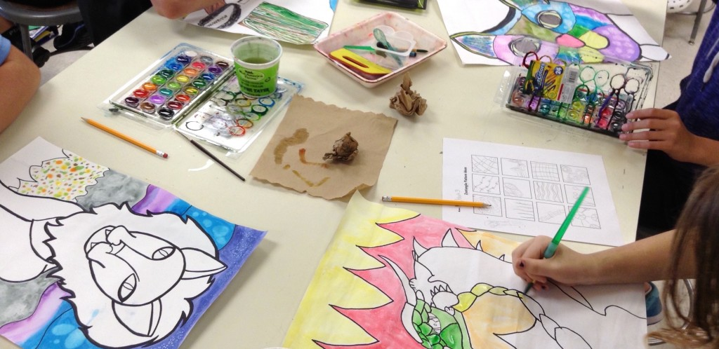 photo of students working on a painting project