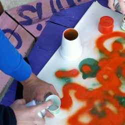 students creating spray paint dots