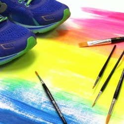 running shoes on top of painting