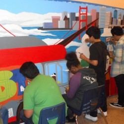 students painting the mural