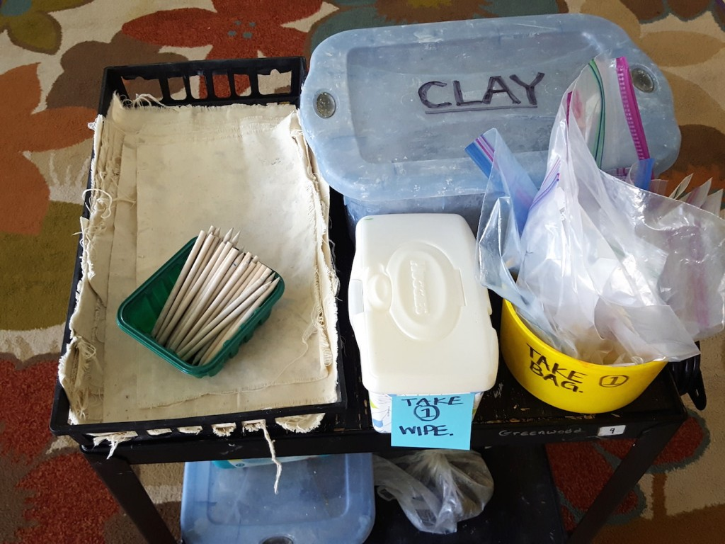 clay cart with supplies