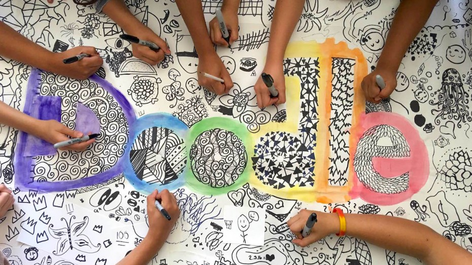 student hands collaboratively doodling