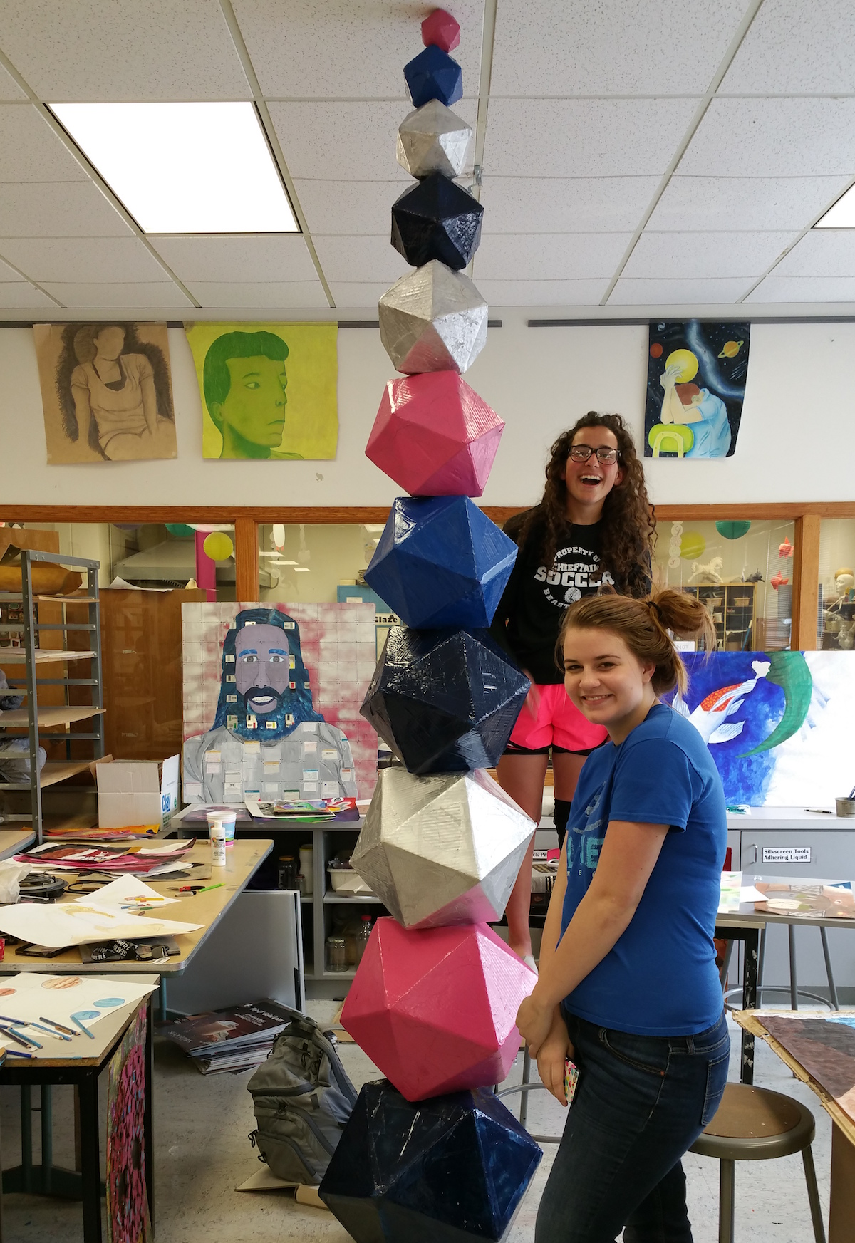 students with super tall sculpture