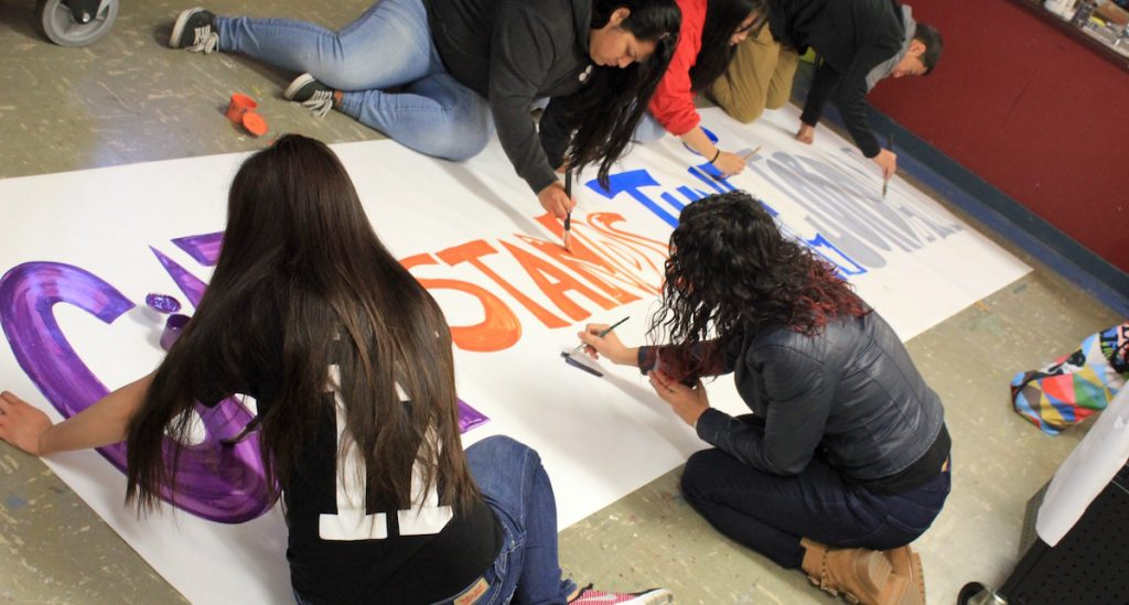 students making sign