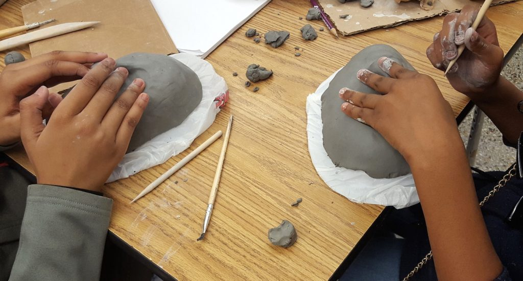 students working with clay