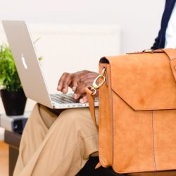 person with computer and computer bag
