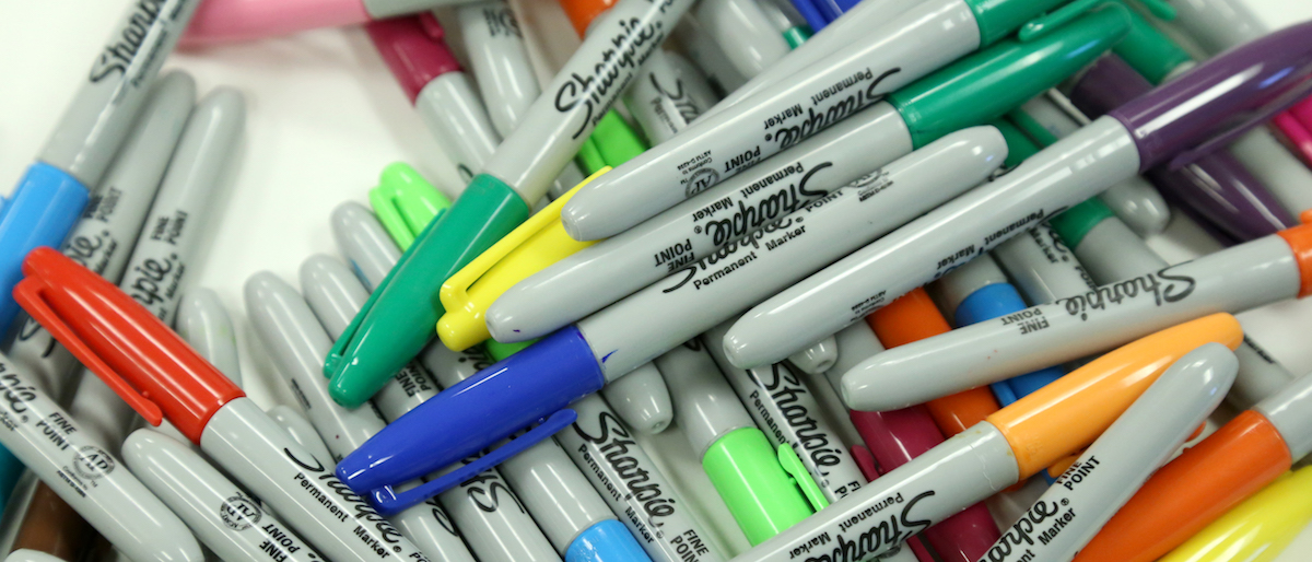Sharpie markers in a pile