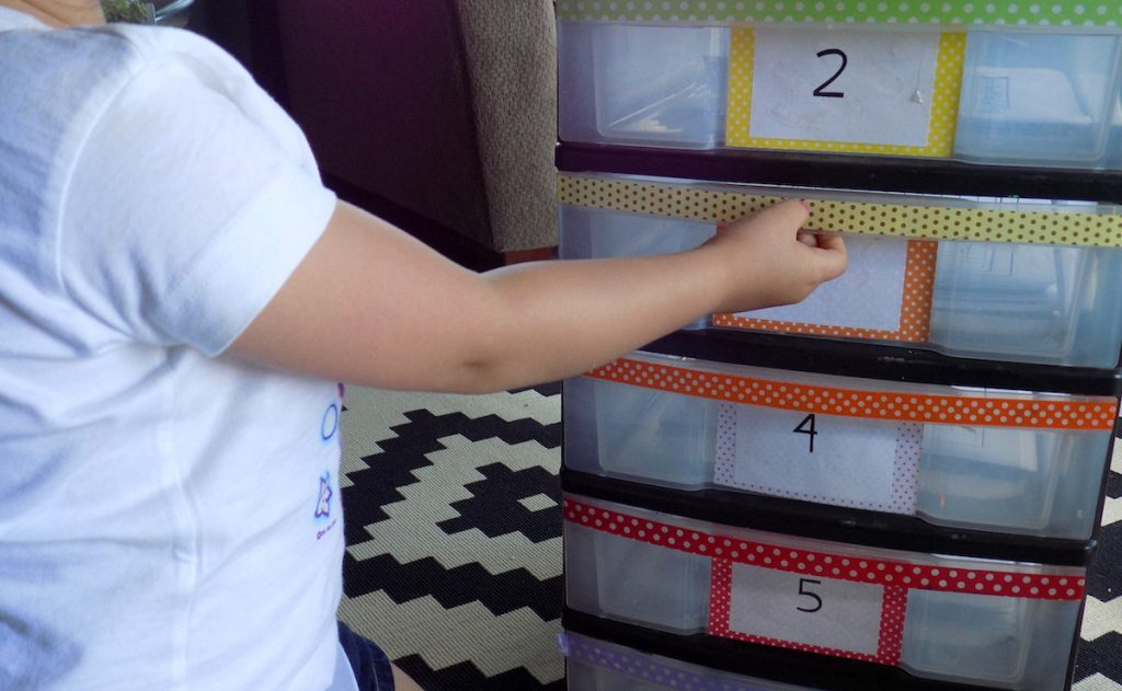 student pulling out early finisher drawer