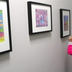 student looking at gallery