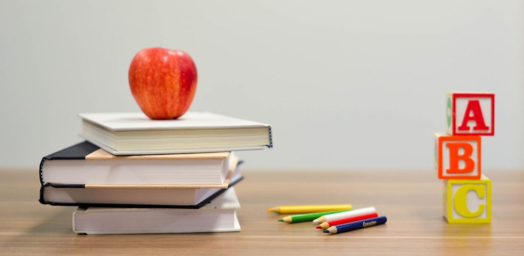 books, apple, and pencil