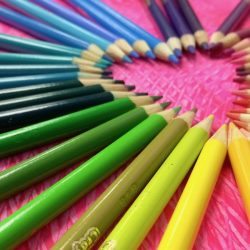 colored pencils in a heart