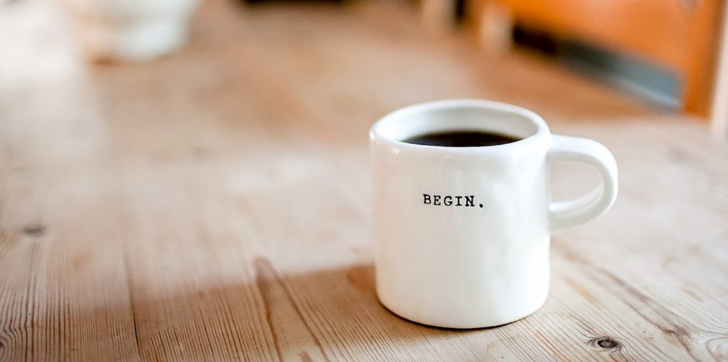 """coffee cup that says """"begin"""""""