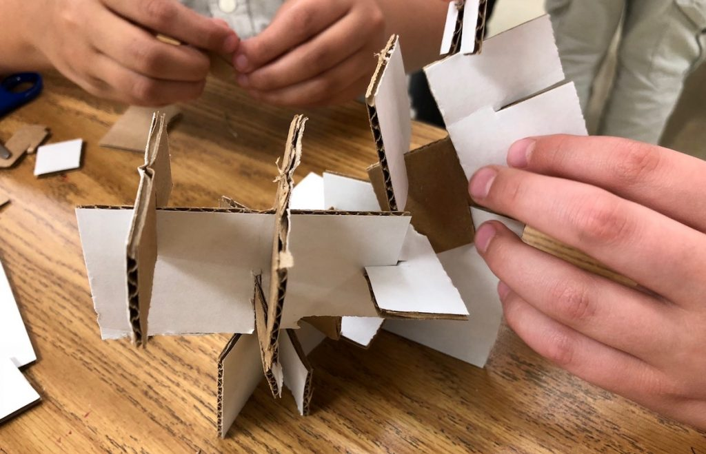 students building with cardboard