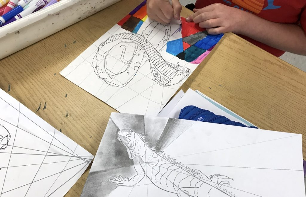 student working on modified drawing