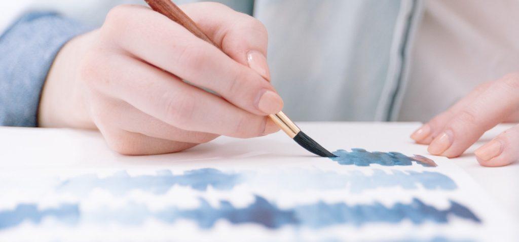 person painting with watercolor