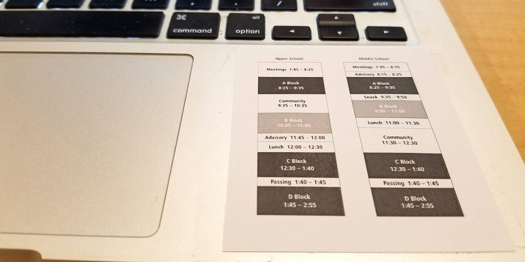 schedule taped to laptop