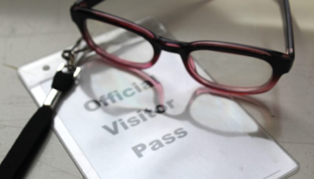 glasses with visitor pass