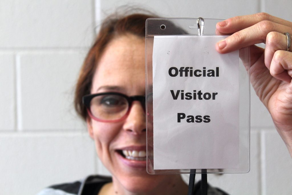 teacher with visitor pass