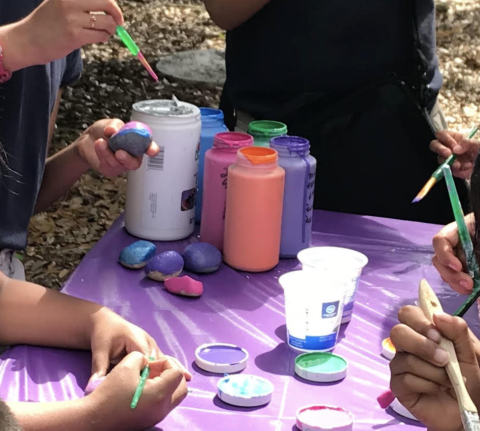 students painting rocks