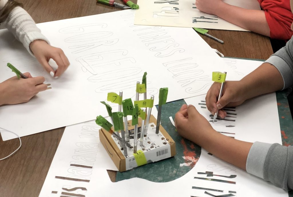 students creating stencils