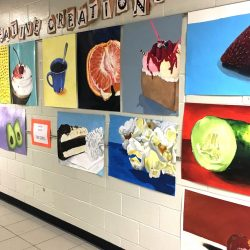 hallway display of food paintings