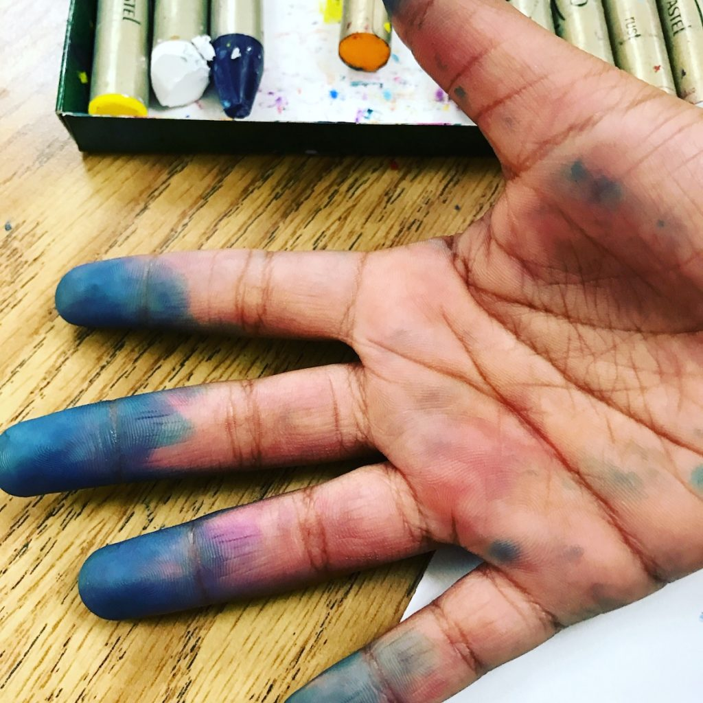 hands stained with ink