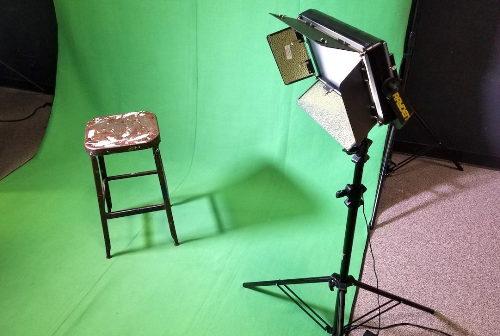 Photo of green screen lights and a chair
