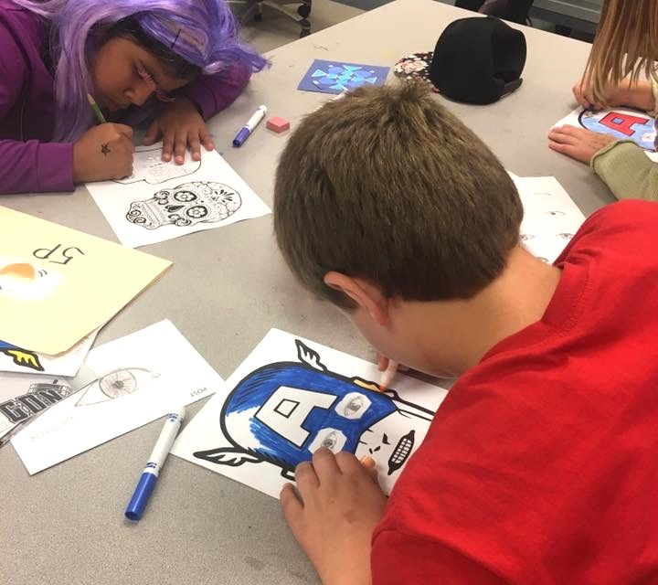 Image of student working on portrait