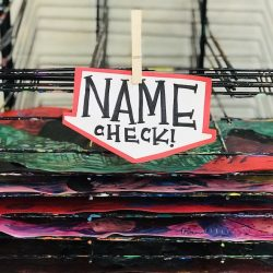 Image with a dry rack with a name check reminder
