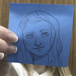 portrait drawn on blue paper