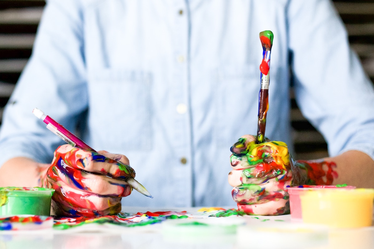 teachers hands messy with paint