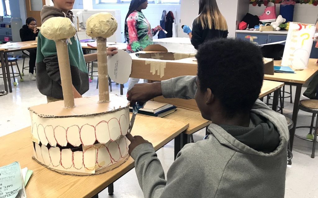 student working with toilet paper rolls