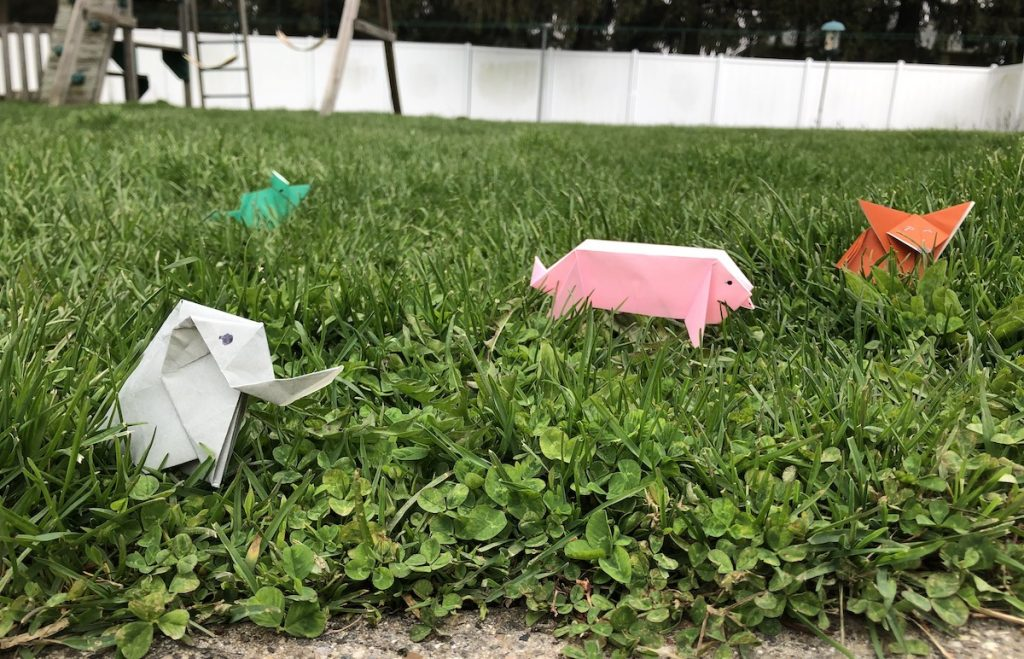 image of paper animals in grass