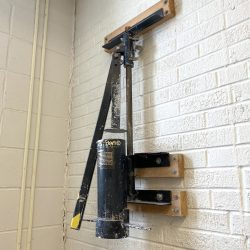 clay extruder mounted on a wall