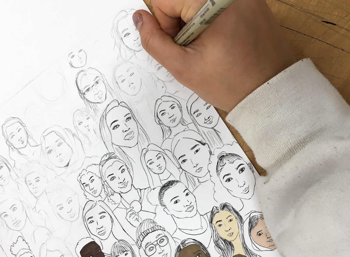 student drawing portraits